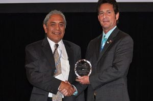 Judge Johnson accepting new mexico consortium award